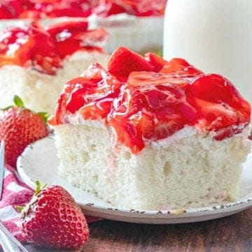 Strawberry Shortcake Cake, slice, served on a small white plate