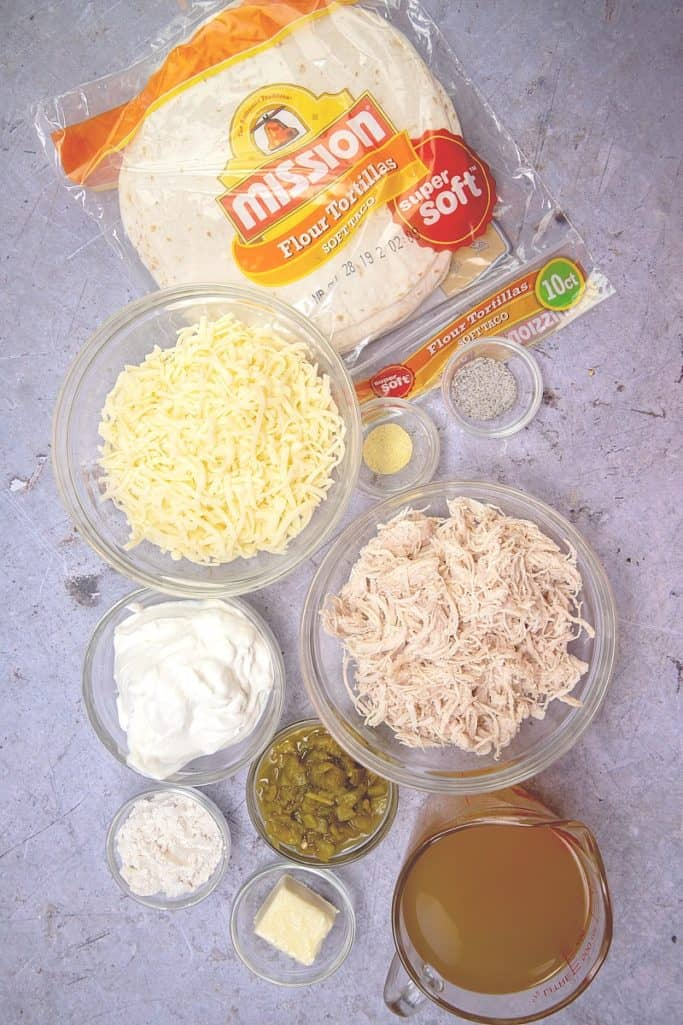 flour tortillas, shredded cooked chicken, Monterey Jack cheese, butter, flour, chicken broth, sour cream, diced green chiles salt, pepper, Adobo seasoning