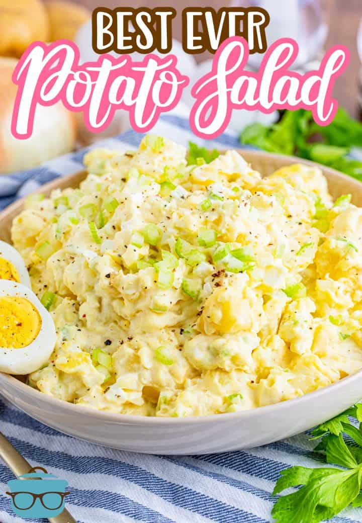 The Best Ever Potato Salad recipe from The Country Cook, potato salad shown in a large shallow bowl with a slice hard boiled egg on the side of the bowl.