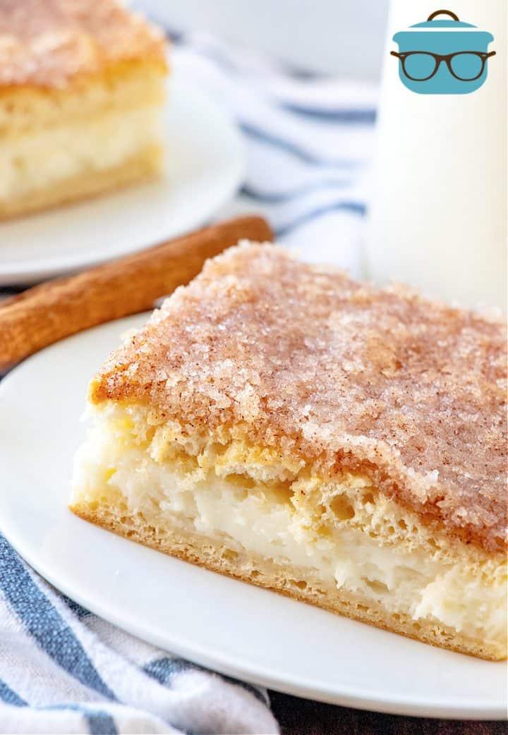 slice of sopapilla cheesecake bar shown on white plate