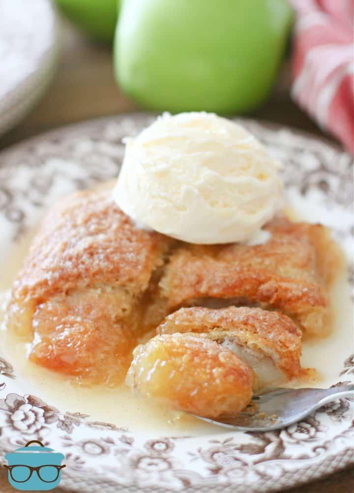 scoop of vanilla ice cream on two apple dumplings n