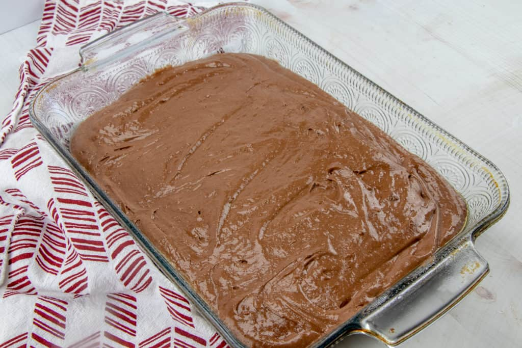 chocolate pudding poured over chocolate cake