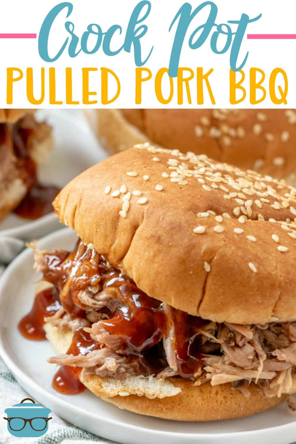 Crock Pot Pulled Pork BBQ recipe from The Country Cook. Closeup photo of pulled pork on a hamburger bun with barbecue sauce drizzled on top of the pork.