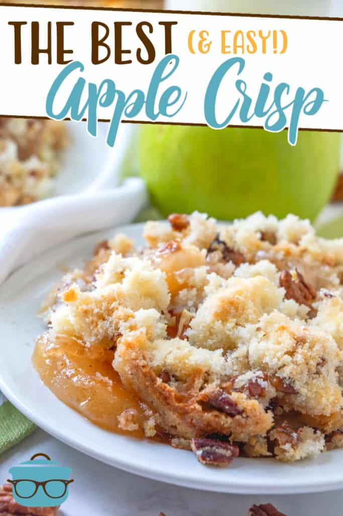 The Best Apple Crisp recipe from The Country Cook, shown served on a small white plate with apples in the background