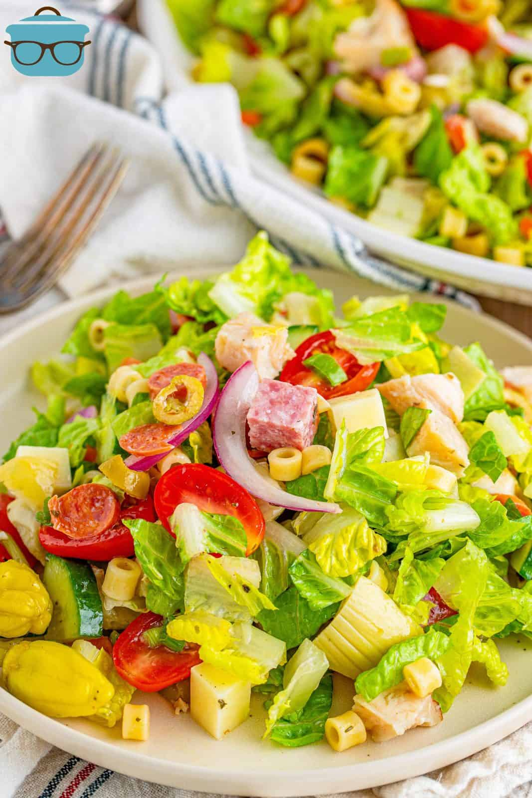 Italian chopped salad shown on a small white salad plate.
