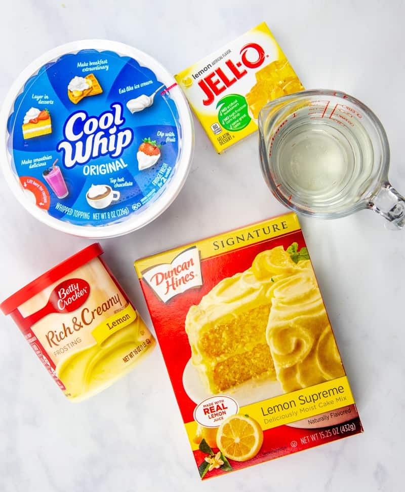 lemon cake mix, eggs, oil, lemon jell-o, hot water, cold water, lemon frosting, whipped topping