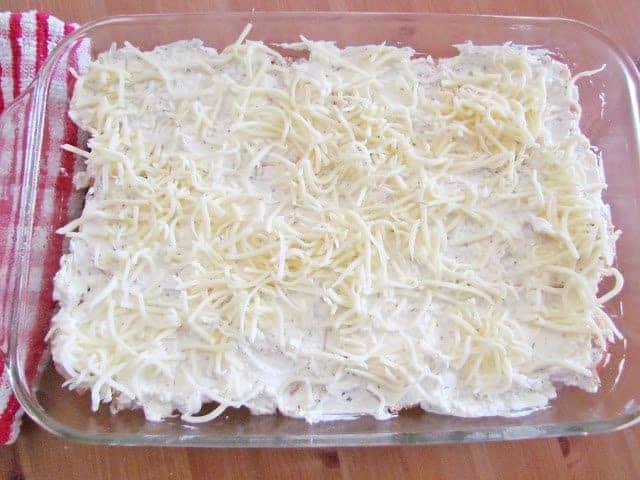 cream cheese mixture spread on top of French bread with mozzarella cheese