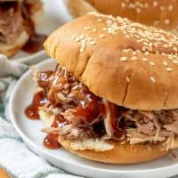 Crock Pot Pulled Pork with BBQ sauce on a bun