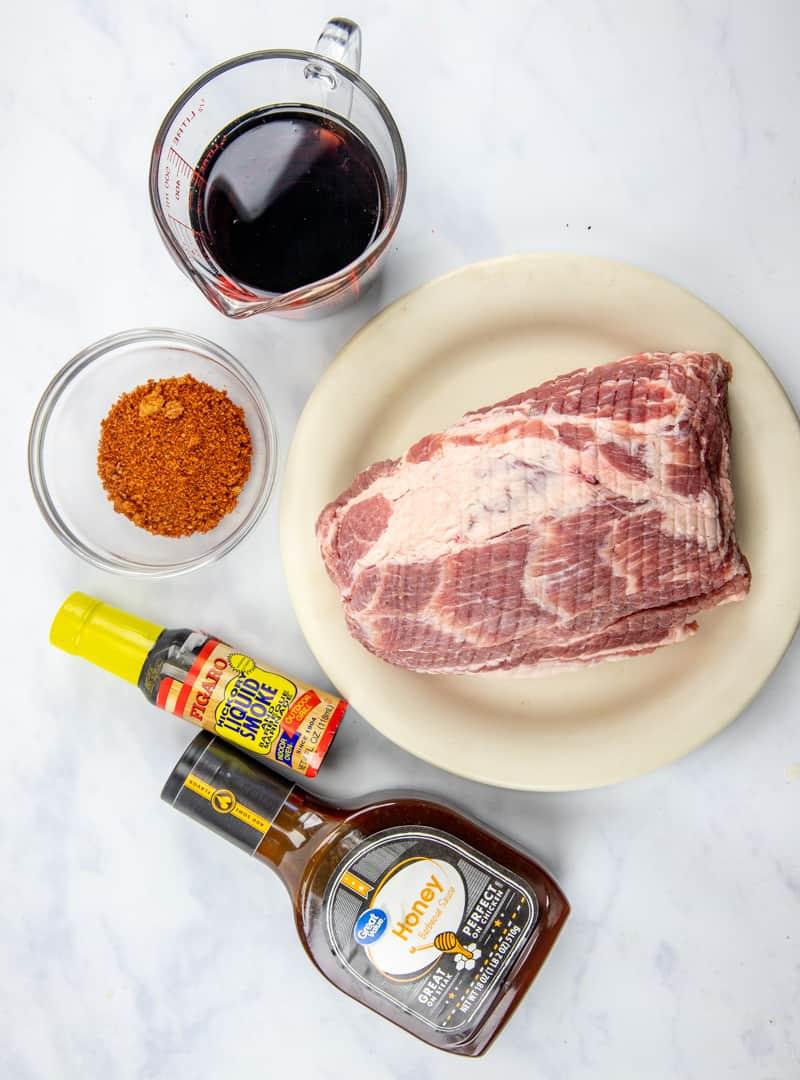 pork shoulder roast (or boneless loin) Dr. Pepper hickory liquid smoke pork rub seasoning (store bought or homemade) BBQ sauce