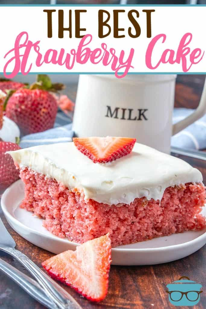 The Best Fresh Strawberry Cake recipe from The Country Cook, slice on a white plate topped with a slice of strawberry
