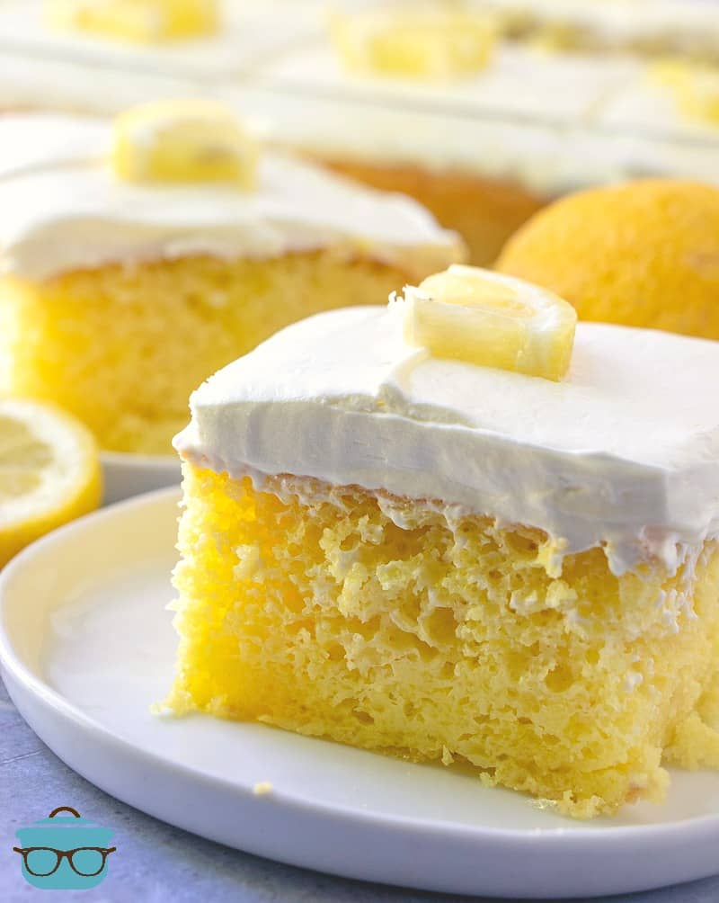 Ultimate Lemon Poke Cake, slice on a plate