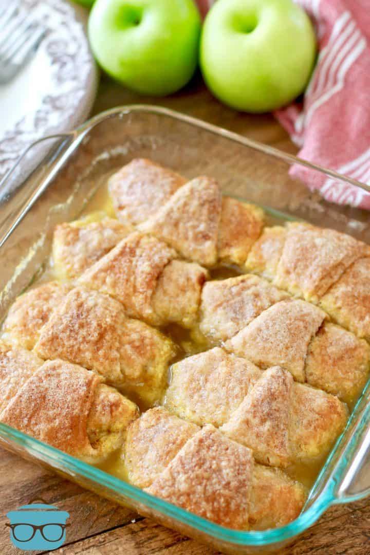 fully baked apple dumplings in a baking dish