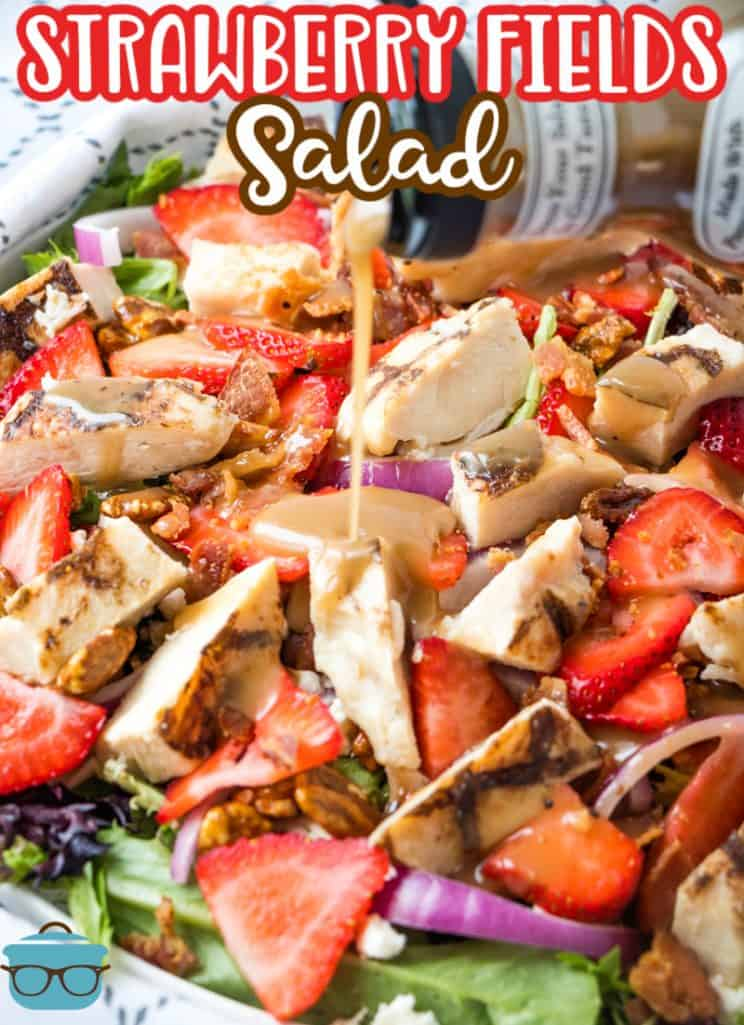 Strawberry Fields Salad recipe from The Country Cook, salad shown in a white bowl while balsamic dressing is poured on top of salad