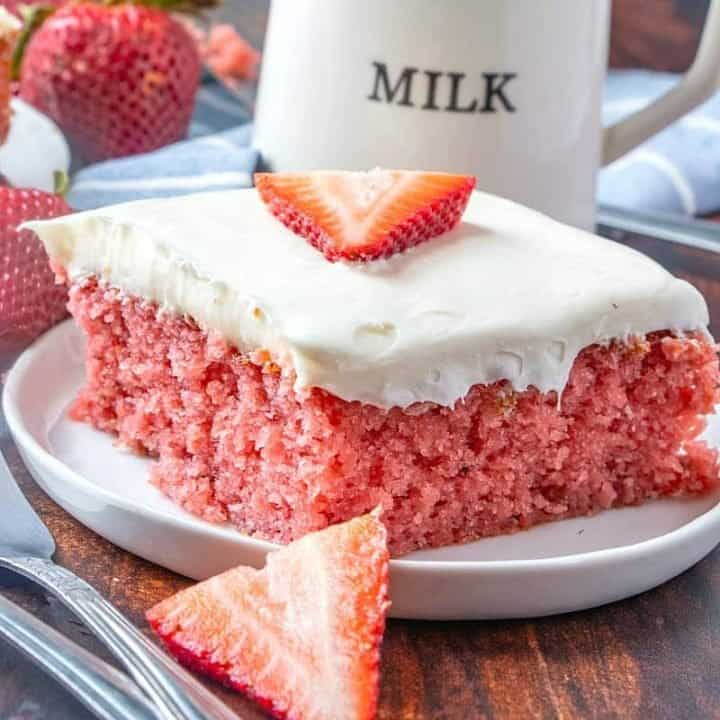 Easy Fresh Strawberry Cake on a white plate with a milk jug in the background