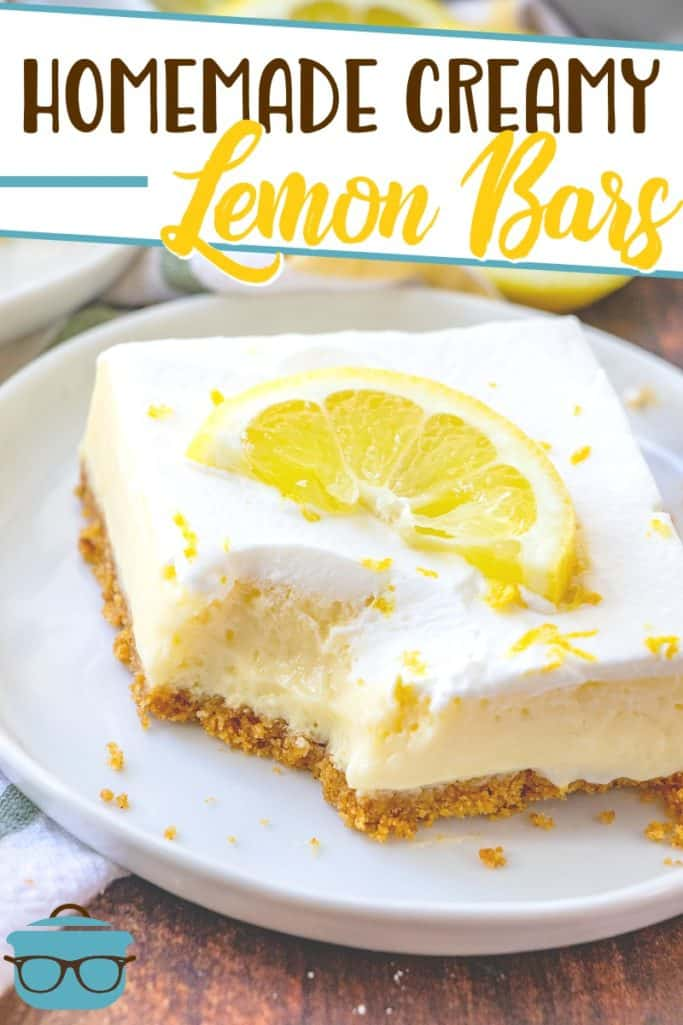 Homemade Creamy Lemon Bars recipe with graham cracker crust from The Country Cook, pictured sliced on a white plate and topped with a lemon slice