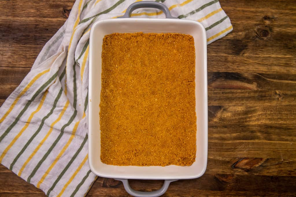graham cracker crust pressed into the bottom of an 11 by 7 baking dish