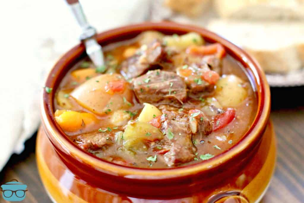 The Best Instant Pot Beef Stew in a bowl with spoon