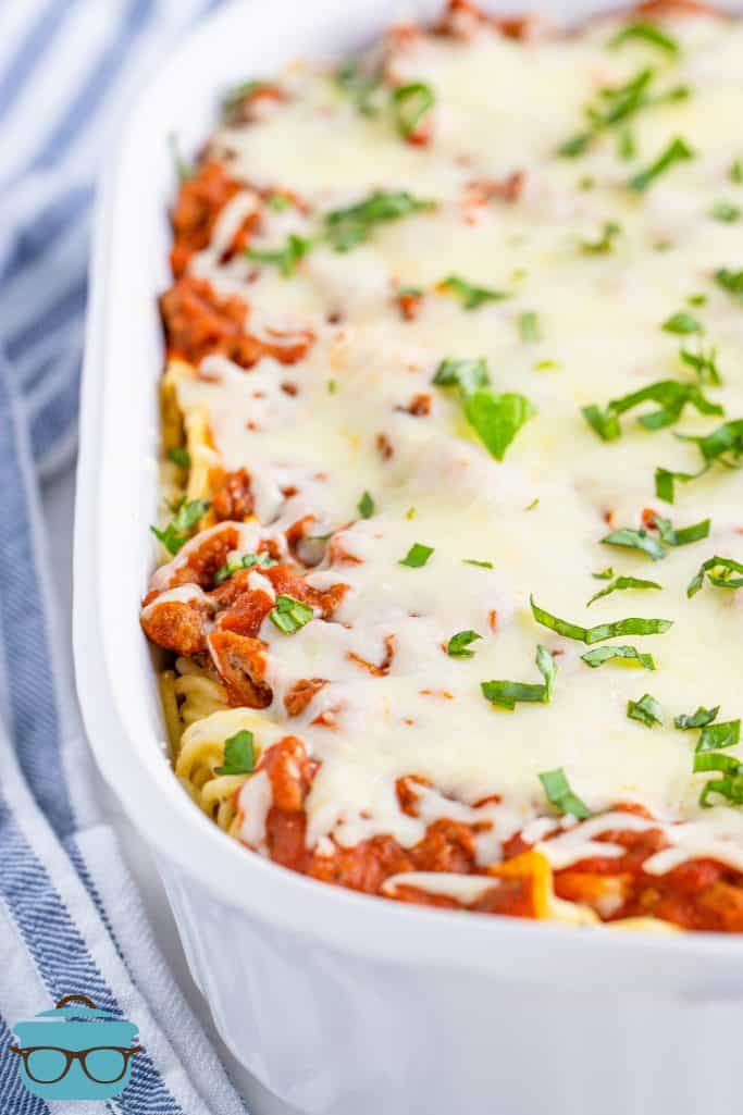fully cooked baked spaghetti shown in a white baking dish