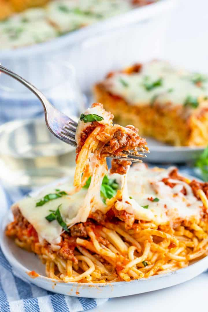 (last image) close up photo of fork pulling up a bite of Baked Spaghetti