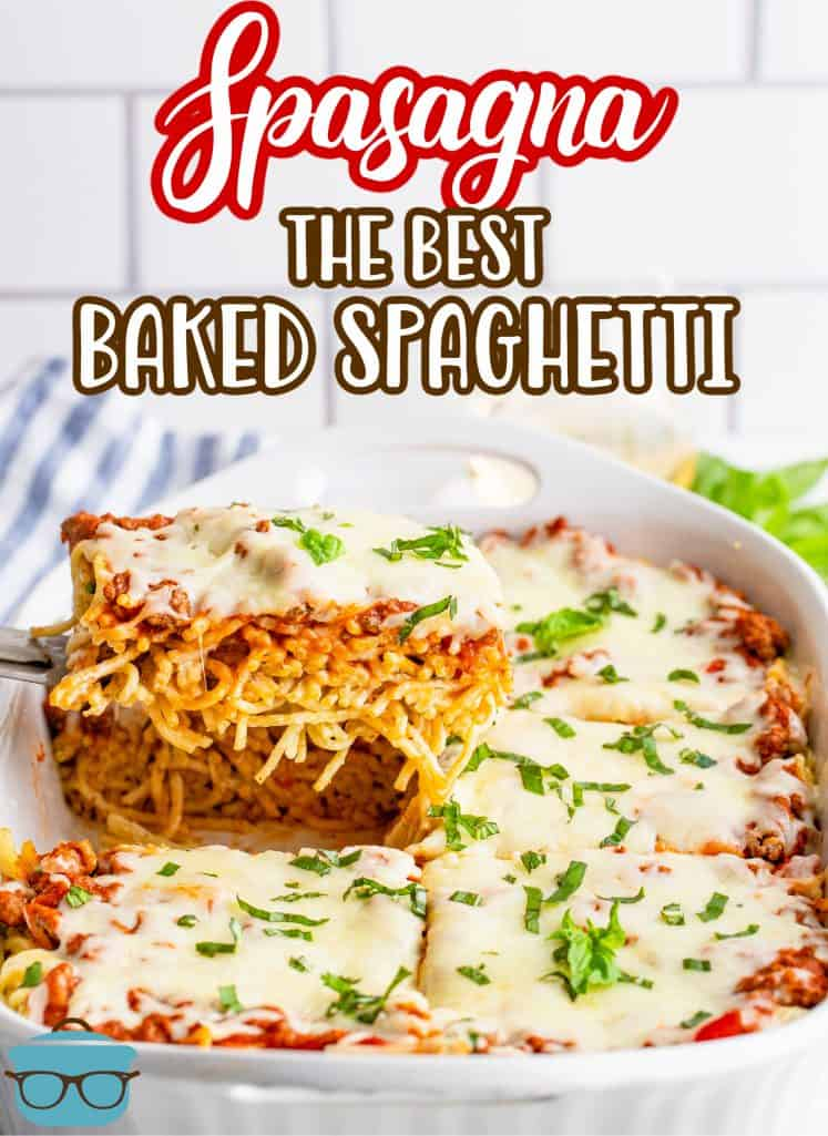 The Best Baked Spaghetti recipe (also known as Spasagna) slice of baked spaghetti shown being pulled out of the casserole dish with a spatula