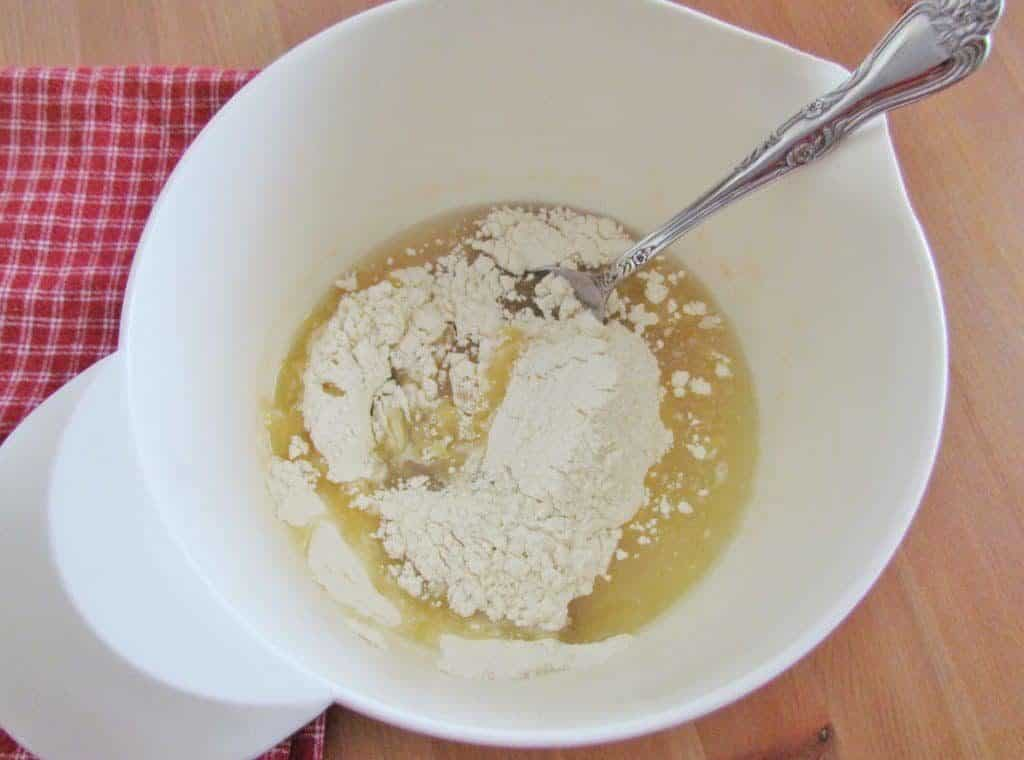 MIXING TOGETHER ALL-PURPOSE FLOUR, WATER, OIL AND SALT INTO A BOWL