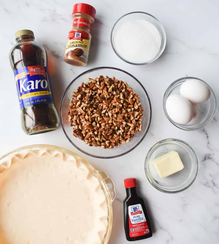 refrigerated pie crust, chopped pecans, eggs, sugar, salted butter, dark corn syrup, ground cinnamon, vanilla extract