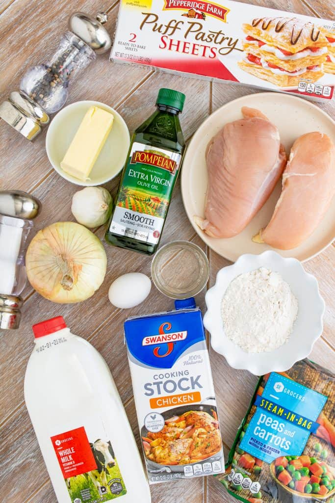 Chicken Pot Pie Ingredients: frozen puff pastry, chicken breasts, olive oil, salt, pepper, salted butter, all purpose flour, whole milk, chicken stock,yellow onion, garlic, frozen peas and carrots, egg, water