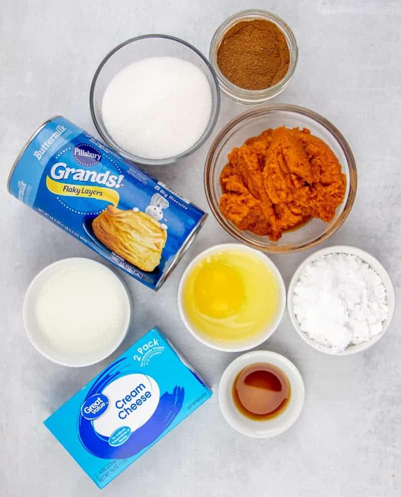 ingredients needed: pure pumpkin puree, sugar, vanilla extract, pumpkin pie spice, Pillsbury Grands Flaky Layers Biscuits, cream cheese, powdered sugar, milk