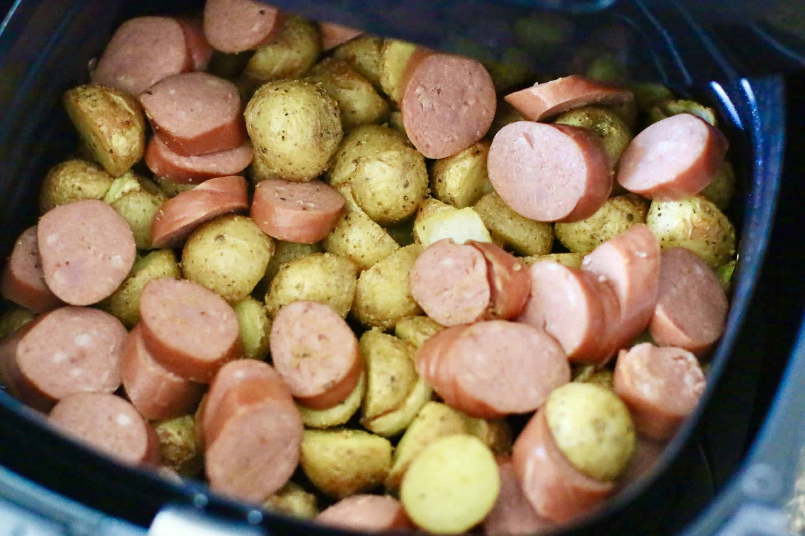 sliced smoked sausage added to cooked potatoes and onions.