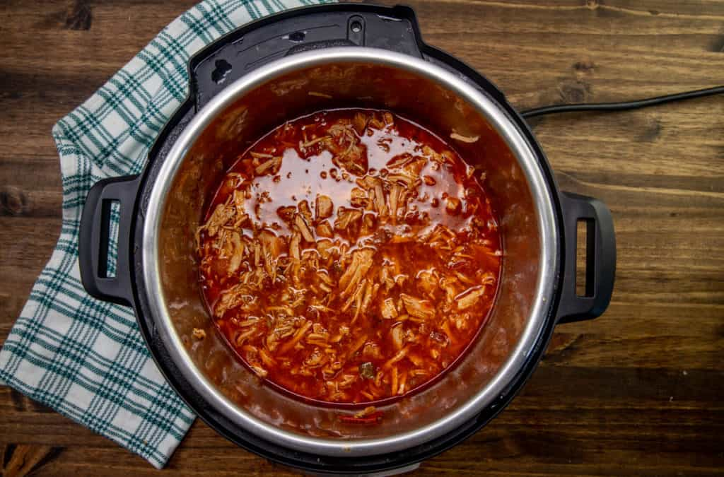 shredded pork in juices in Instant Pot