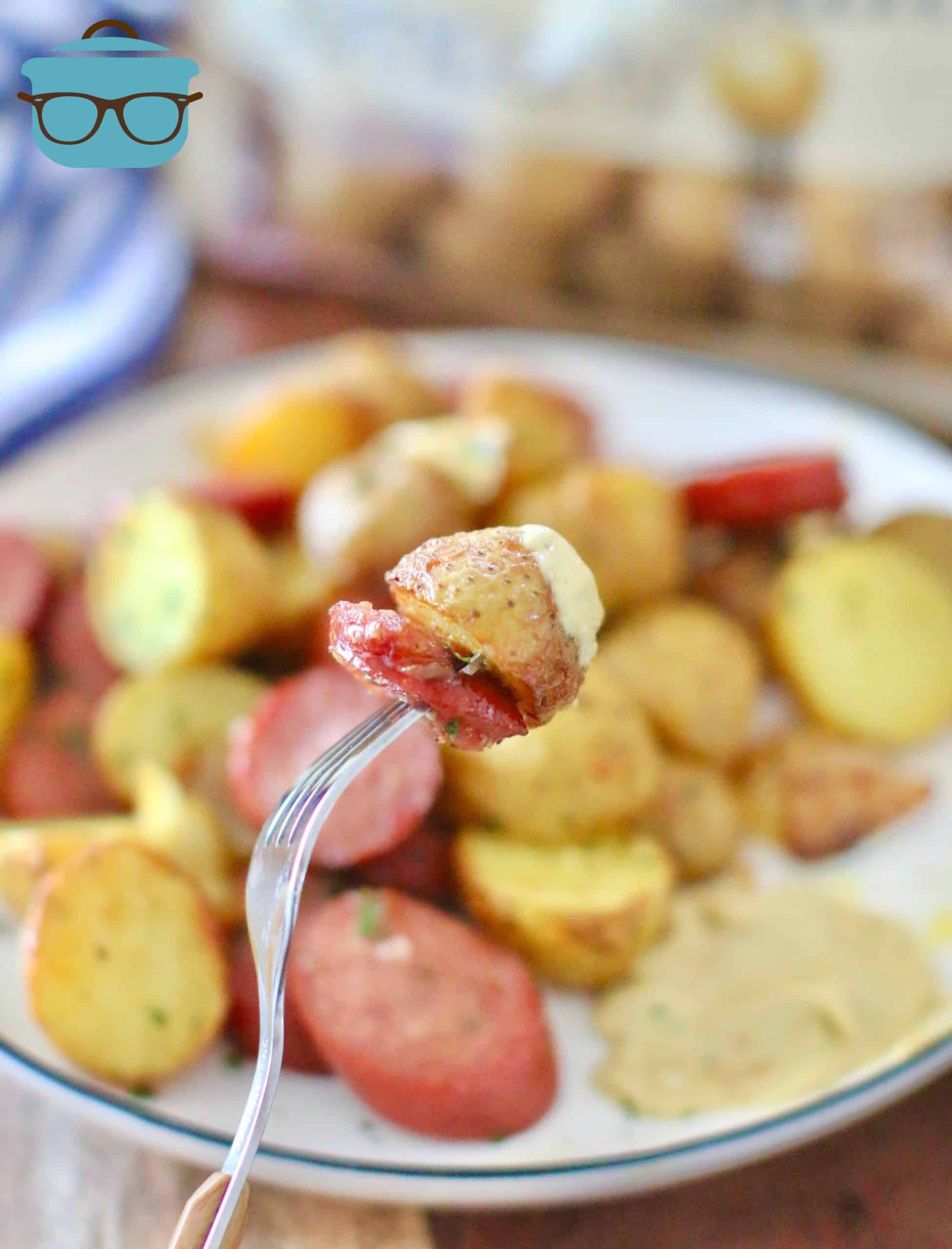Air Fried Potatoes and Sausage on a fork topped with honey mustard.
