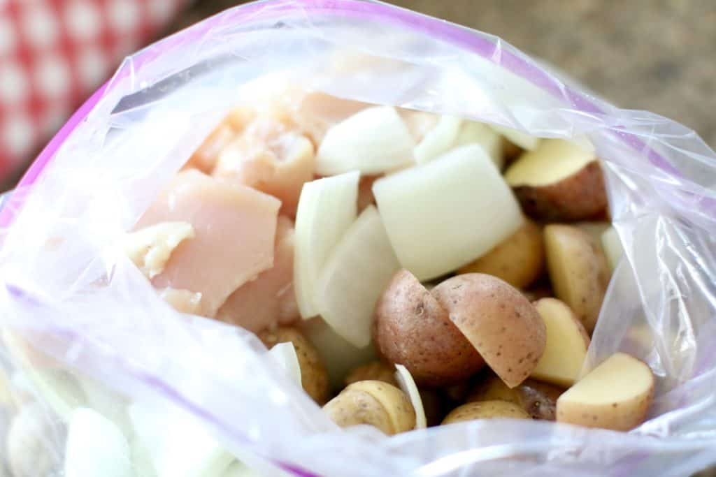 diced potatoes, onions and chicken in a large ziploc bag