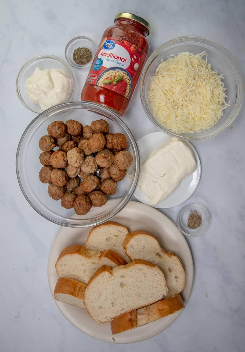 Italian bread, spaghetti sauce, frozen meatballs, mozzarella, cream cheese, mayo, Italian seasoning.