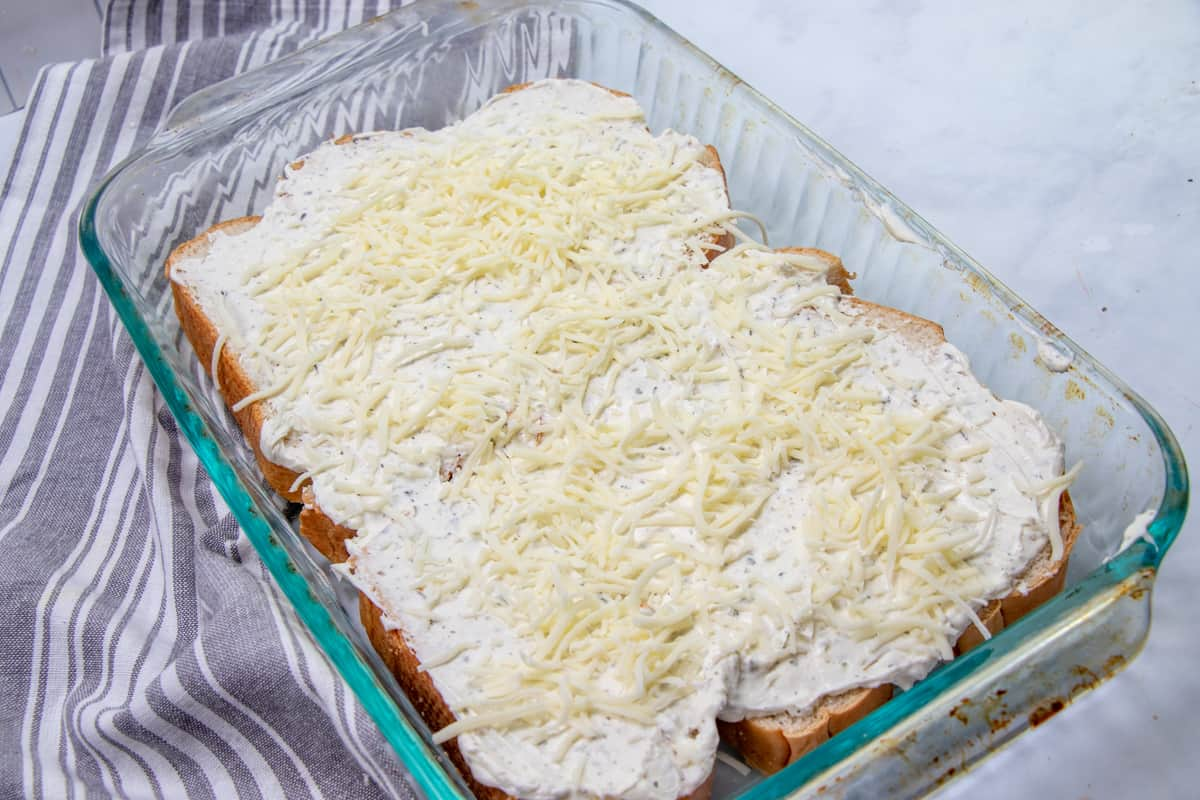 cream cheese mixture spread on top of French bread with mozzarella cheese.