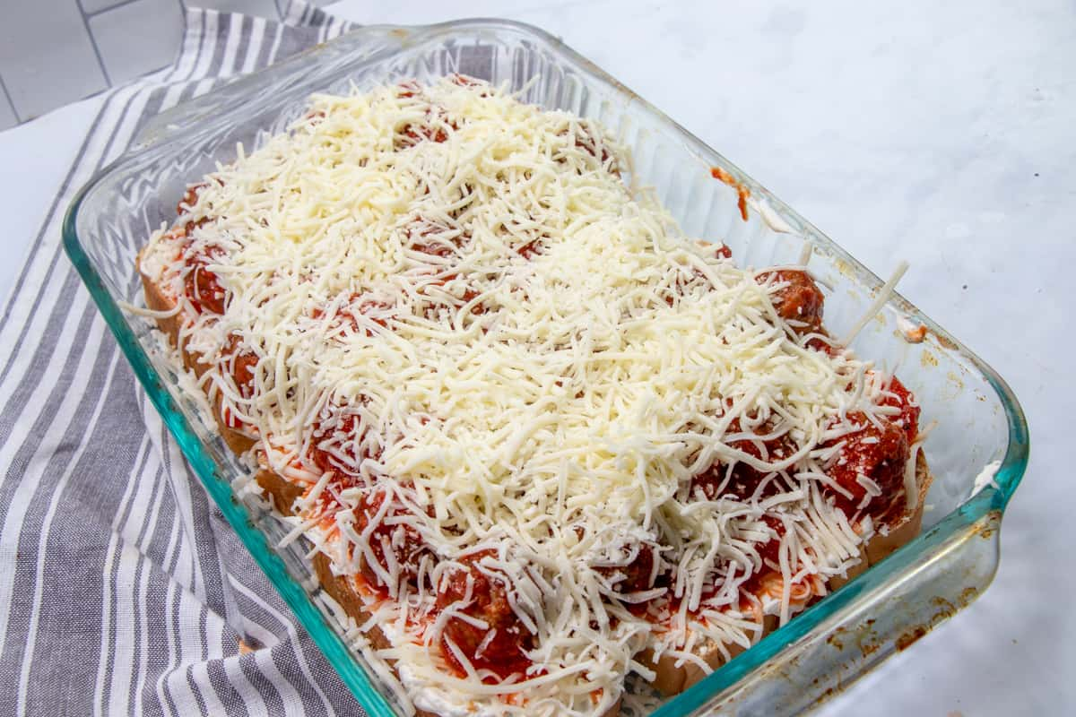 shredded mozzarella cheese sprinkled evenly over the meatball sub casserole layers.