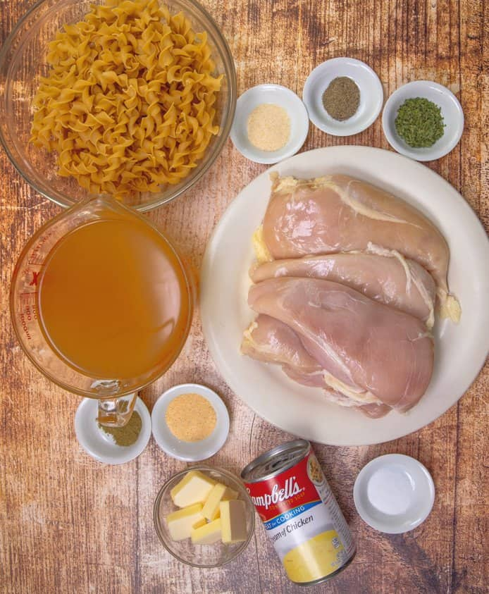 boneless, skinless chicken breasts, cream of chicken soup, salt, pepper, poultry seasoning, garlic powder, onion powder, salted butter, chicken broth, medium egg noodles, dried parsley