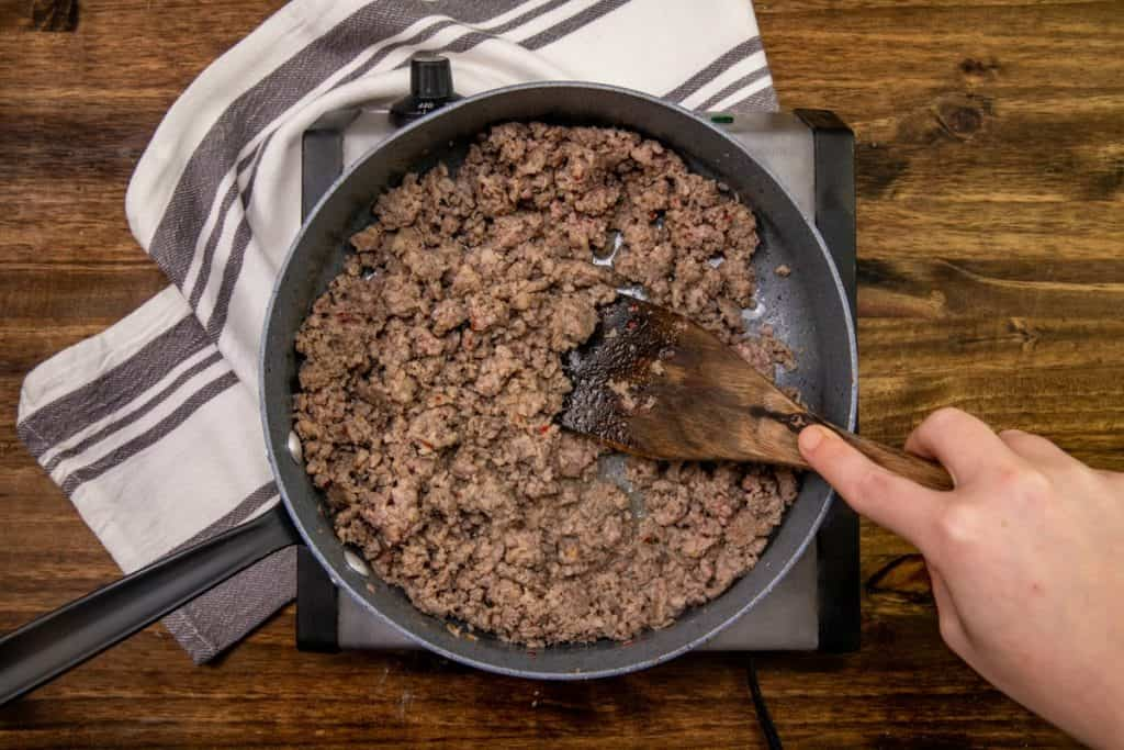 ground pork sasauge cooked and crumbled in a skillet