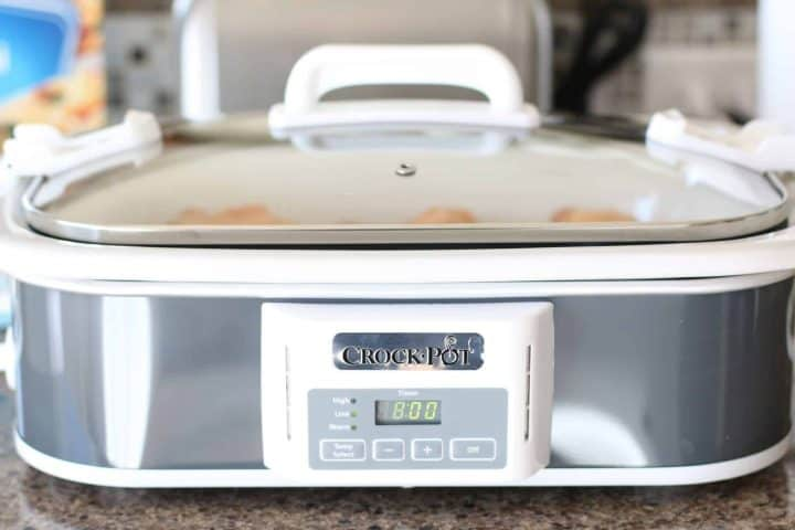 covered casserole white and silver slow cooker.