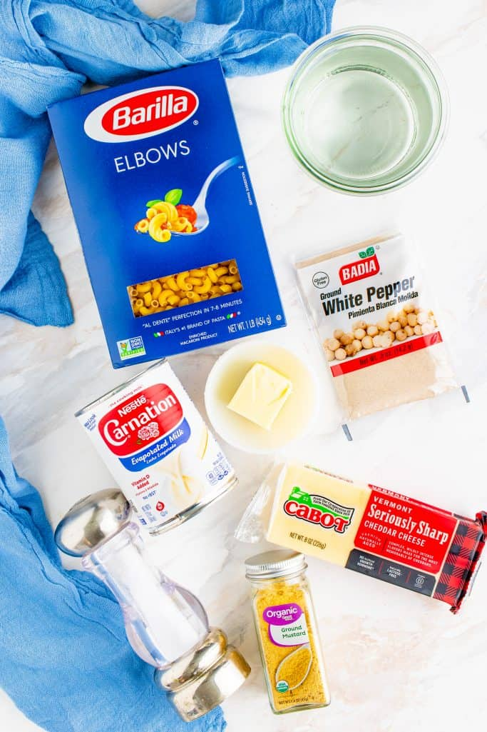 Instant Pot Macaroni and Cheese ingredients: elbow macaroni noodles, water, salted butter, evaporated milk, freshly shredded cheddar cheese, salt, dry mustard powder
