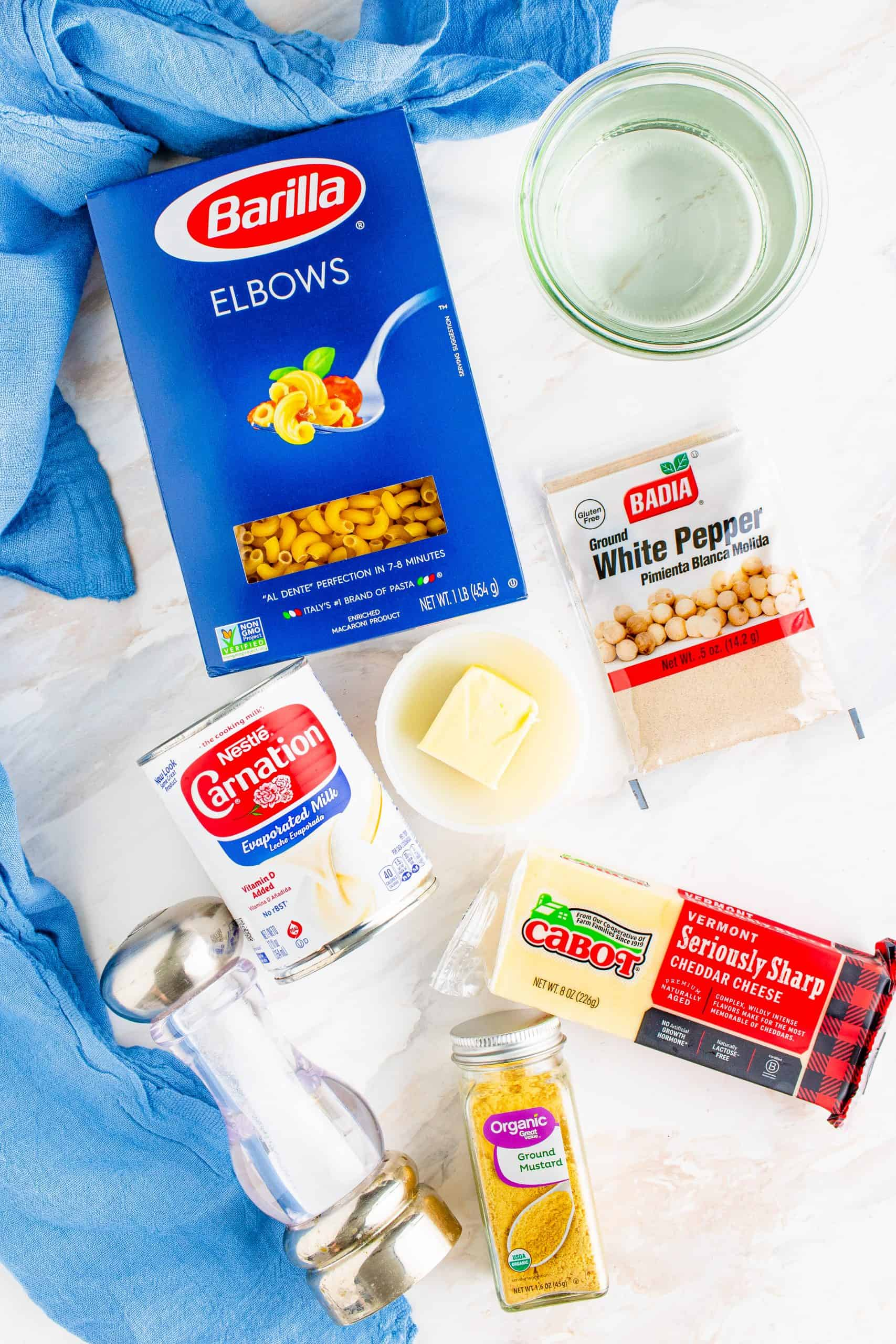 Instant Pot Macaroni and Cheese ingredients: elbow macaroni noodles, water, salted butter, evaporated milk, freshly shredded cheddar cheese, salt, dry mustard powder.
