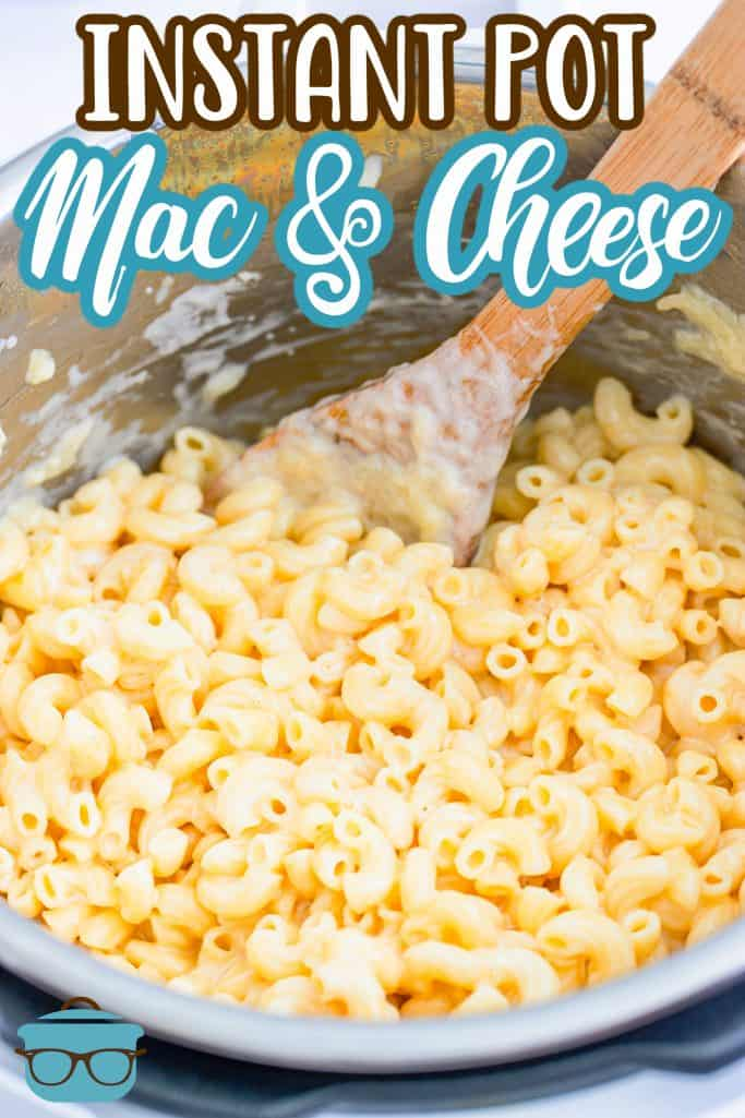 Instant Pot Macaroni and Cheese recipe from The Country Cook, macaroni shown in the instant pot with a wooden spoon