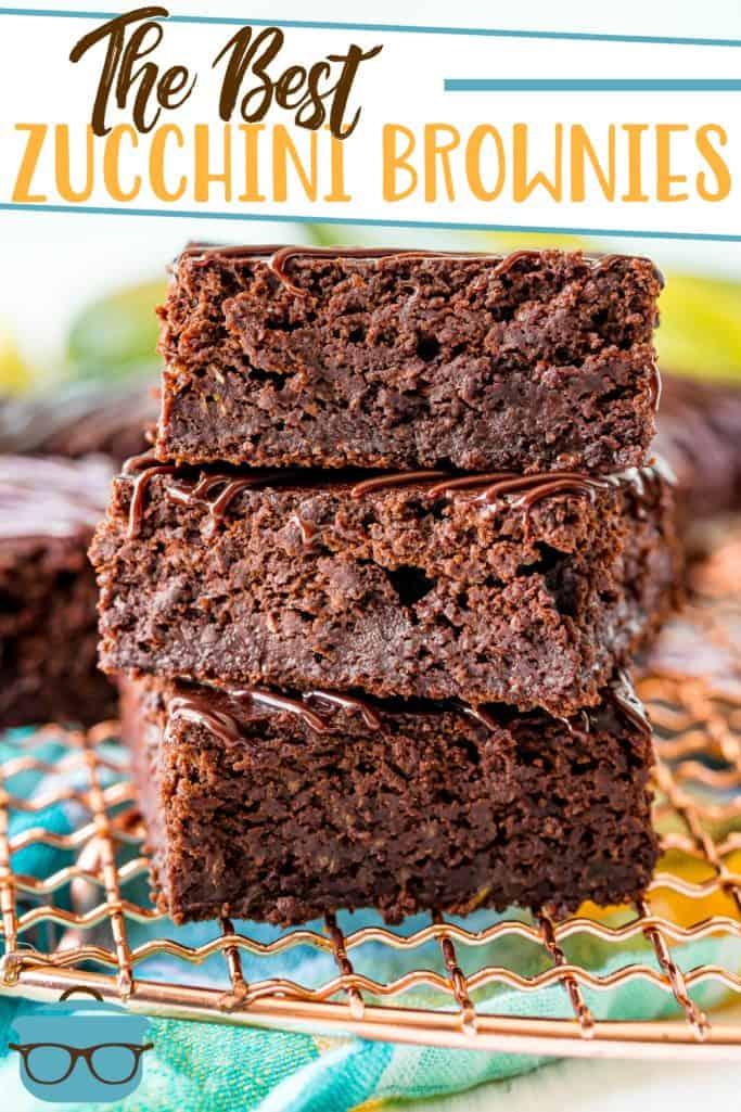 The Best Zucchini Brownies recipe from The Country Cook, main image showing three brownies stacked on a wire rack