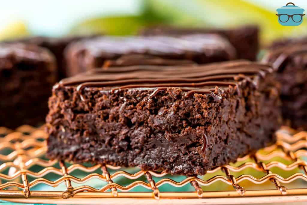 closeup, zucchini brownie on a gold wire rack