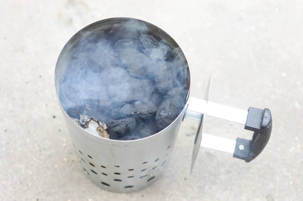 charcoal briquettes and newspaper in a chimney starter