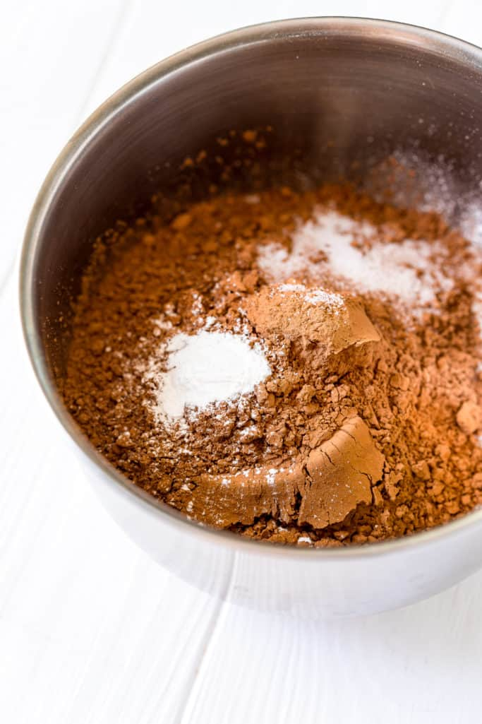 fry ingredients added to wet ingredients in a stand mixer bowl