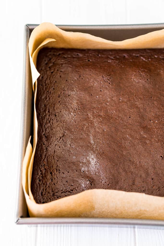 fully baked zucchini brownies cooling in the baking pan