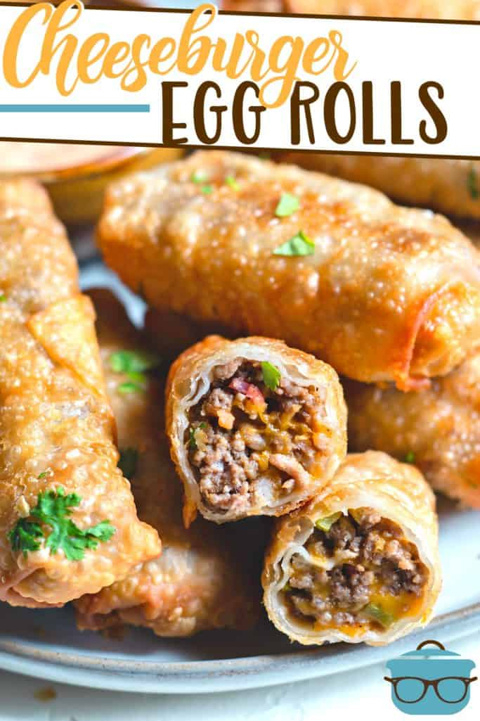 Bacon Cheeseburger Egg Rolls recipe from The Country Cook, shown stacked on a plater with one egg roll autopen to see the inside