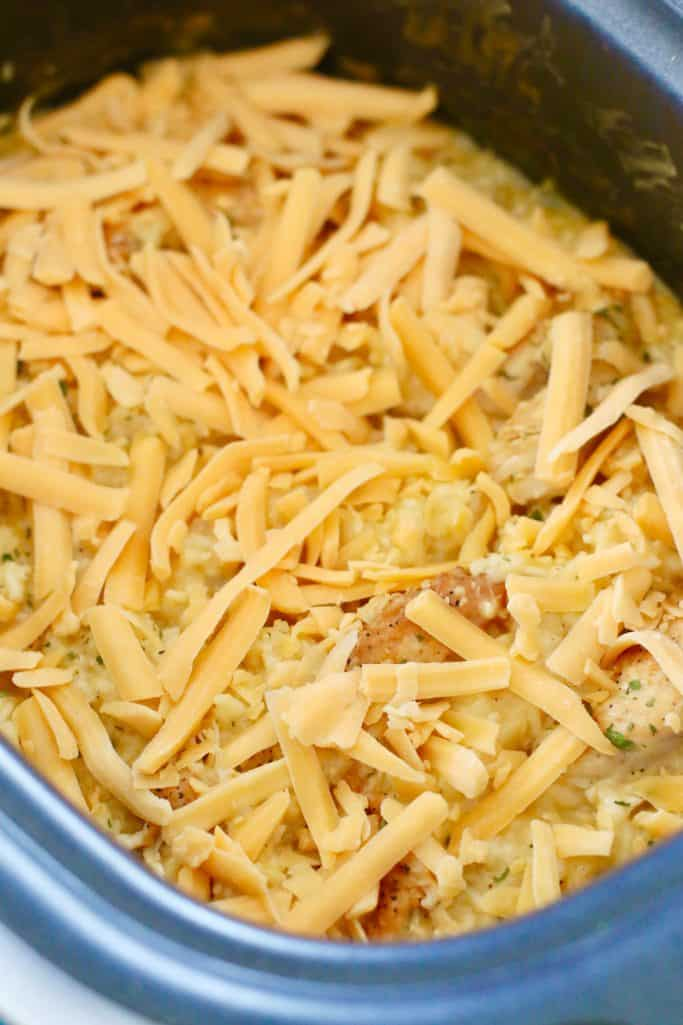 shredded cheddar cheese added to the top of chicken and rice mixture