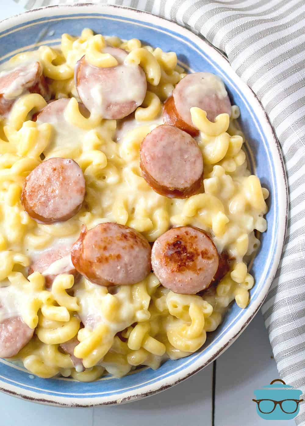Instant Pot Sausage White Cheddar Macaroni and Cheese shown served in a bowl.