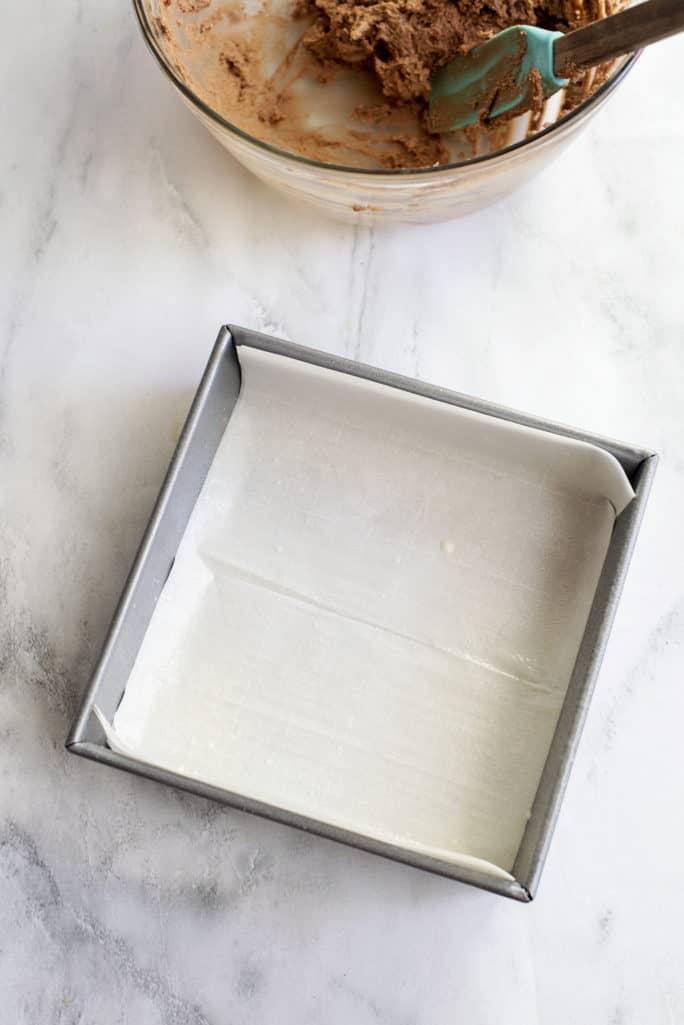 parchment paper-lined baking dish